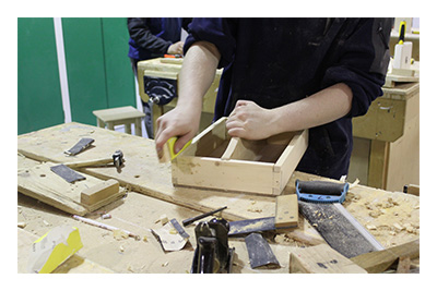 Young person in woodwork room